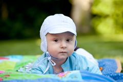 Baby boy in garden Royalty Free Stock Photos