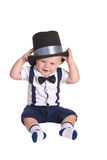 Baby boy gentleman putting on cylinder hat Stock Photography