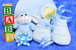 Baby Boy Gift with Blocks. Assorted gifts for a baby boy with ribbons, bows and baby blocks stock photos