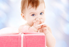 Baby boy with gift box Stock Image