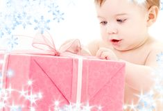Baby boy with gift box Stock Images