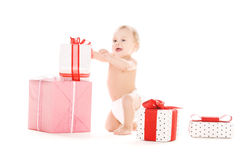 Baby boy with gifts Stock Image