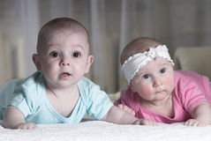Baby boy and girl Stock Photos