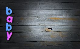 Baby, Boy, Girl, Boards, Background. Baby background for boys and girls. Blue letters are for a boy, pink for girl. Old vintage barn boards make up the graphic Royalty Free Stock Photo