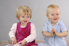 Baby boy and girl playing. Beautiful baby boy  and girl expressing friendship Stock Photography