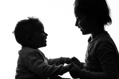 Baby boy and girl silhouette over white background. Stock Photos