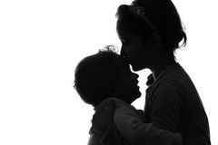 Baby boy and girl silhouette over white background. Royalty Free Stock Images