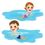 Baby Boy And Girl Swimming. Baby boy and baby girl swimming alone happy Stock Photography
