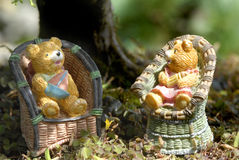 Baby boy and girl teddy bears. Sitting on the countryside Royalty Free Stock Photos