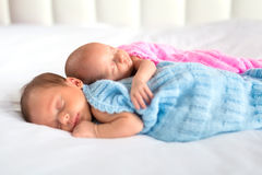 Baby boy and girl twins in bed Royalty Free Stock Image