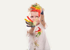 The baby boy with  gouache soiled hands and shirt isolated Royalty Free Stock Photo