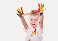 The baby boy with  gouache soiled hands and shirt isolated Stock Photography