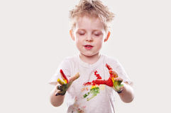 The baby boy with  gouache soiled hands and shirt isolated Royalty Free Stock Image