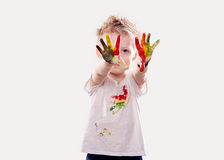 The baby boy with  gouache soiled hands and shirt isolated Stock Photo