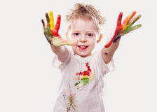 The baby boy with  gouache soiled hands and shirt isolated Royalty Free Stock Photos