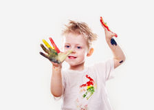 The baby boy with  gouache soiled hands and shirt isolated Royalty Free Stock Photography