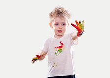 The baby boy with  gouache soiled hands and shirt isolated Royalty Free Stock Images