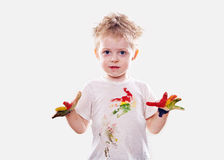 The baby boy with  gouache soiled hands and shirt isolated Stock Image