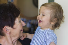 Baby boy and grandmother. Grand-mother holds a baby boy in her arms Royalty Free Stock Photo