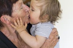 Baby boy and grandmother. Grand-mother holds a baby boy in her arms Royalty Free Stock Photos