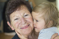 Baby boy and grandmother stock photography
