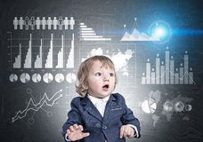 Baby boy and graphs on blackboard royalty free stock photo
