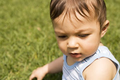 Baby boy in the grass Royalty Free Stock Photos