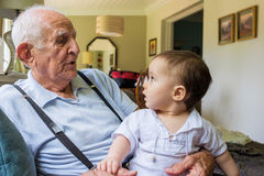 Baby boy with great grandfather Royalty Free Stock Images