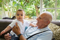 Baby boy with great grandfather Royalty Free Stock Image