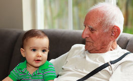 Baby boy with great grandfather Stock Image