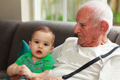 Baby boy with great grandfather Stock Images