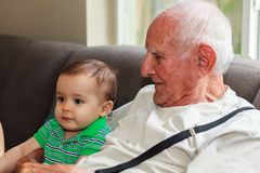 Baby boy with great grandfather Stock Photo