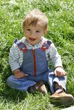 Baby boy in green grass Royalty Free Stock Photo