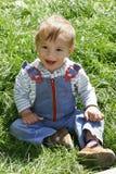 Baby boy in green grass. Happy baby boy in green grass Royalty Free Stock Photo