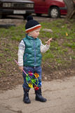 Baby boy in green jaket and blue jeans. Full length portrait of a beautiful baby boy walking in spring park. Little boy in green jaket and blue jeans, outdoors Stock Image
