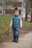Baby boy in green jaket and blue jeans Royalty Free Stock Photos
