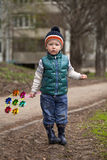Baby boy in green jaket and blue jeans Stock Images