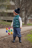 Baby boy in green jaket and blue jeans Royalty Free Stock Images