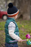 Baby boy in green jaket and blue jeans Royalty Free Stock Image
