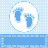 Baby boy greeting card with foot steps Stock Image