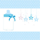 Baby boy greeting card hanging stars and bottle background Stock Photography