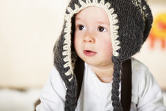 Baby boy with grey cap looking innocently. Stock Photo