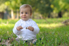 A baby-boy grimacing. Royalty Free Stock Photography
