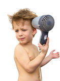 Baby boy with hair dryer over white Stock Images
