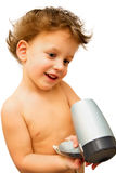 Baby boy with hairdryer over white Royalty Free Stock Photo