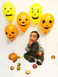 Baby boy and Halloween Stock Image