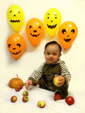 Baby boy and Halloween Stock Images