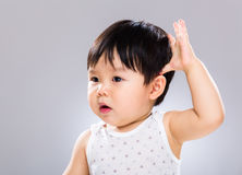Baby boy hand touch head Stock Photography