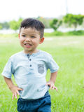 Baby boy with hand on waist and walking to front. Asian young little boy at outdoor stock image