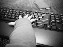Baby boy hands on the computer keyboard Royalty Free Stock Photo